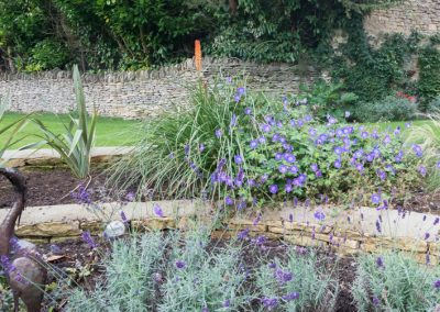 Cotswold stone walling with cottage garden planting