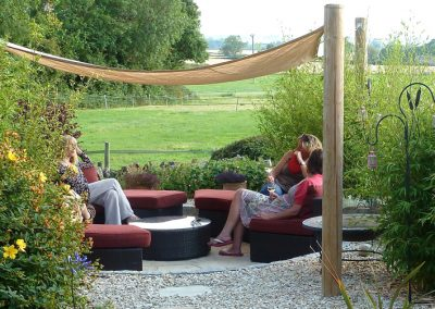 Sunken seating area with shade sail over