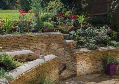 Cotswold stone retaining walls and curved steps